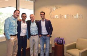 Summer interns and current MBA students Mark Fergason, BA'08, Kartik Varma, and Sid Shetty, join Cardinal Health CEO George Barrett (third from left) for a group photo. Fergason and Shetty will join Cardinal after graduation, while Varma is joining American Airlines, another company that enjoys a strong Owen alumni network.