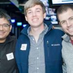 """Alok Choksi, MSF'13, JD'16 (left), Matthew Trautman, MSF'13 (center), and Nathan Leiphardt, MSF'13, reunite at Saturday evening's class parties at Topgolf (see """"Parting Shots,"""" inside back cover)."""