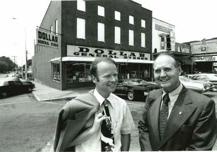 Cal Turner Jr., left, and Cal Turner Sr. chat outside a store in Scottsville, Kentucky, where their company began. Today, Dollar General is headquartered just outside Nashville, with stores in 44 states.