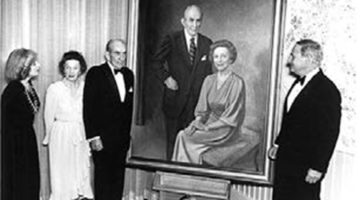 "School benefactors Lulu and Ralph ""Peck"" Owen attend the unveiling of their portrait, which hangs in Management Hall. Their legacy of giving continues today through the family of their nephew, Charles Robb Swaney."