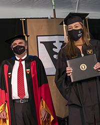 2020 graduate receiving diploma