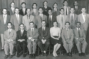 black and white formal group photo of GPED's first cohort of 22 students