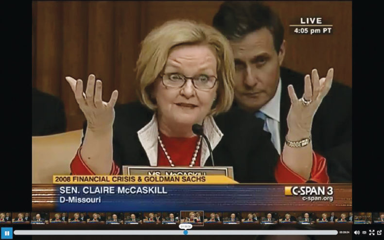 Screen shot of Claire McCaskill speaking on CSPAN with Gary Brown behind her