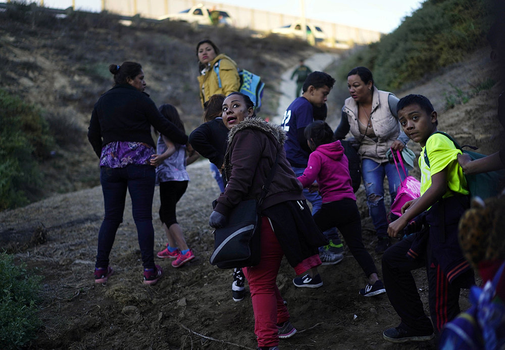 photo of immigrants crossing the US-Mexico border