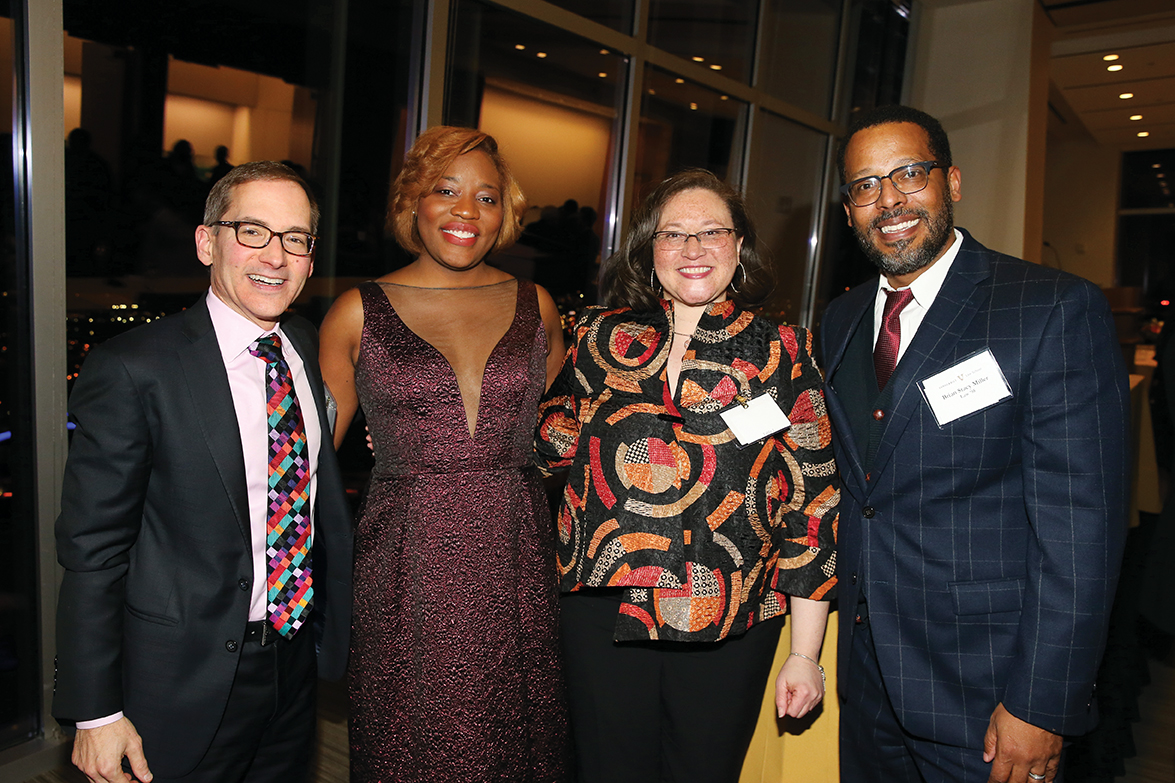 photo of Chris Guthrie with alumni panelists