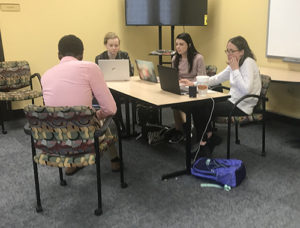 Just City Program Assistant Erin Pounders (right) with Brooke Bowerman '22 (center back), Jennifer King '21 (left) and Wesley Dozier '19 at an expungement clinic held at a local Memphis library.
