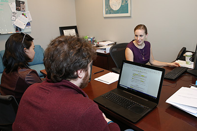 Professor Lauren Rogal meets with students in the Turner Family Community Enterprise Clinic.