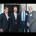 Jim Cuminale '78, Associate Dean Scotty Mann, David Gelfand '87, (BA'84) and Frank Garrison '79, (BA'76) at a NYC alumni reception held at Hudson Yards.