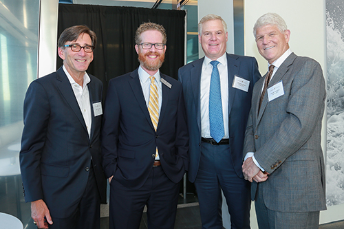 Jim Cuminale '78, Associate Dean Scotty Mann, David Gelfand '87, (BA'84) and Frank Garrison '79, (BA'76) at a NYC alumni reception held at Hudson Yards.
