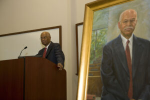 Professor Bob Belton delivers remarks at his portrait unveiling in 2010.
