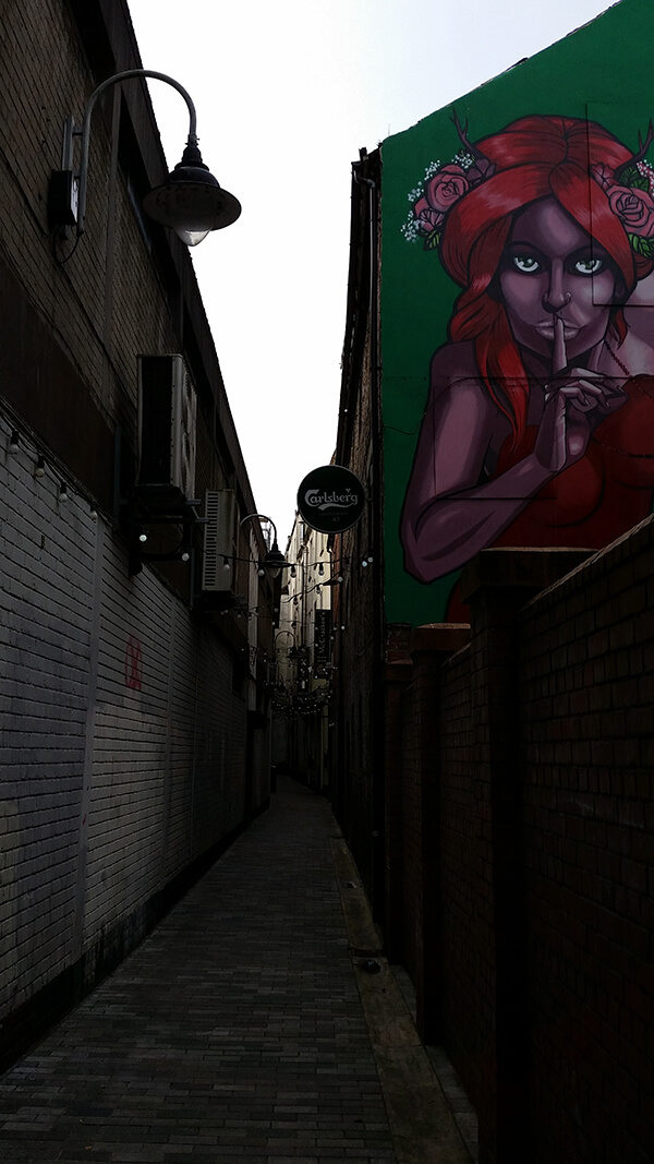 A mural on the side of a pub near the city centre