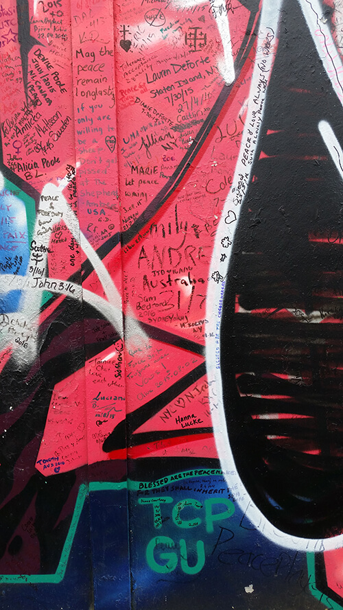 Examples of the murals and visitor messages on the Peace Walls