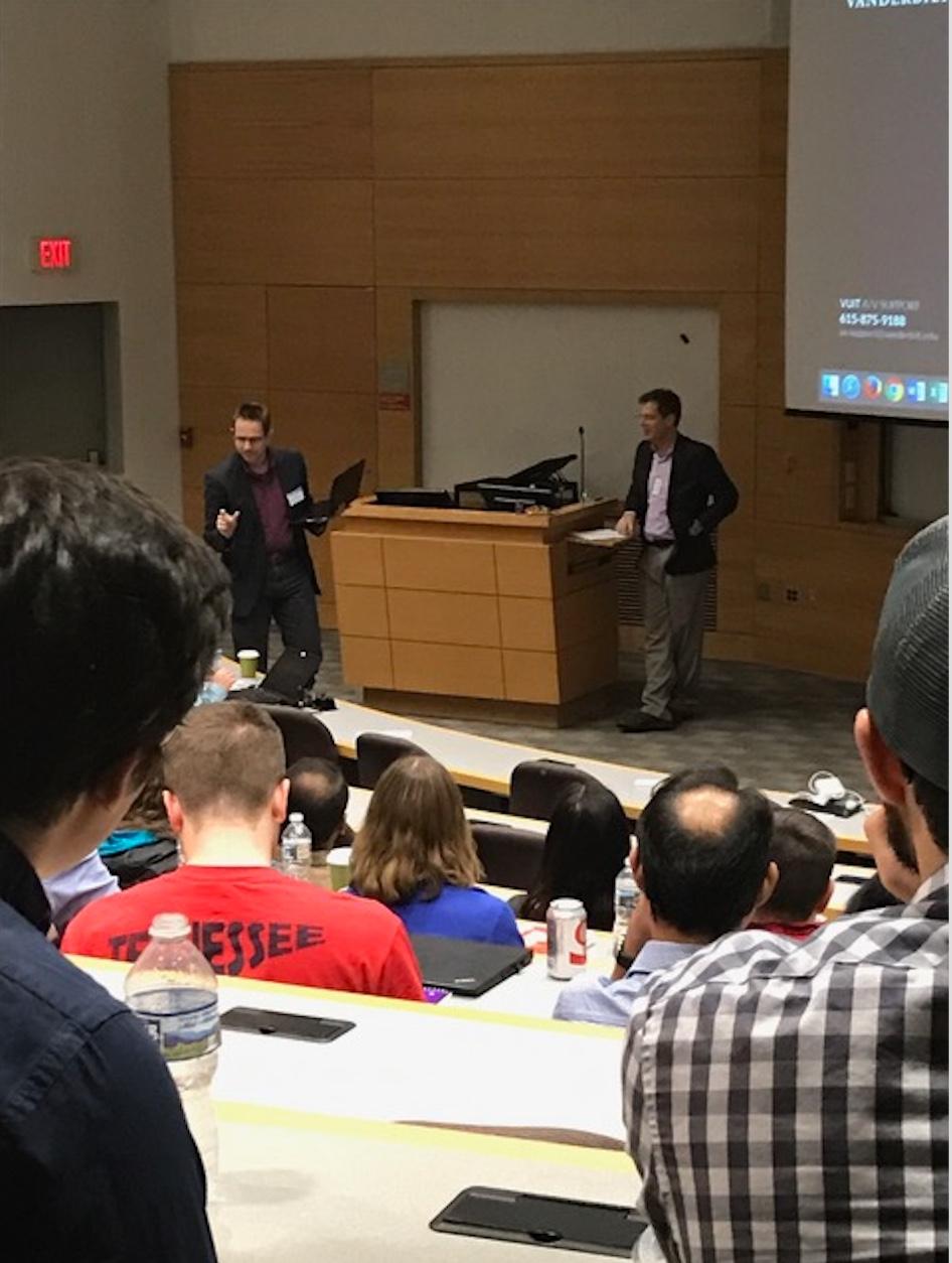 Jens Meiler and James Crowe, Jr. speak to attendees