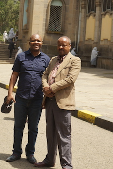 Moses Ochonu with one of the guides in front of the historic Holy Trinity Cathedral in Addis Ababa.