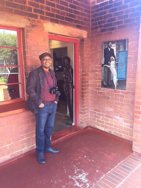 Moses Ochonu, History Department, in front of the Mandela Family House in Soweto.
