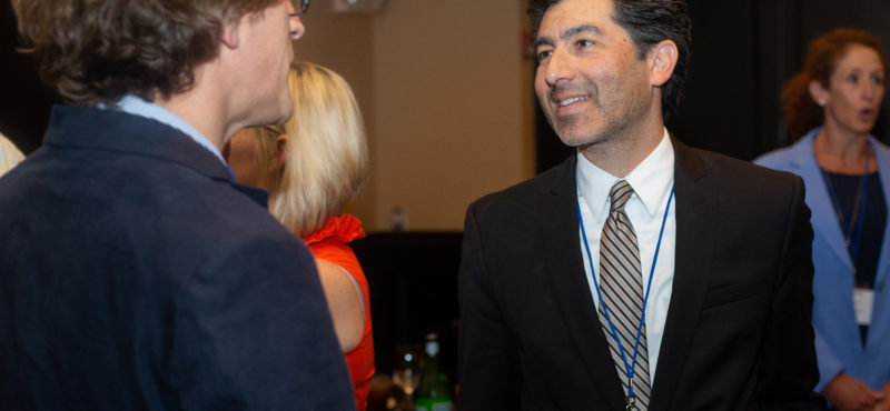 Director Keivan Stassun chats with an attendee at the TPI CEO Luncheon