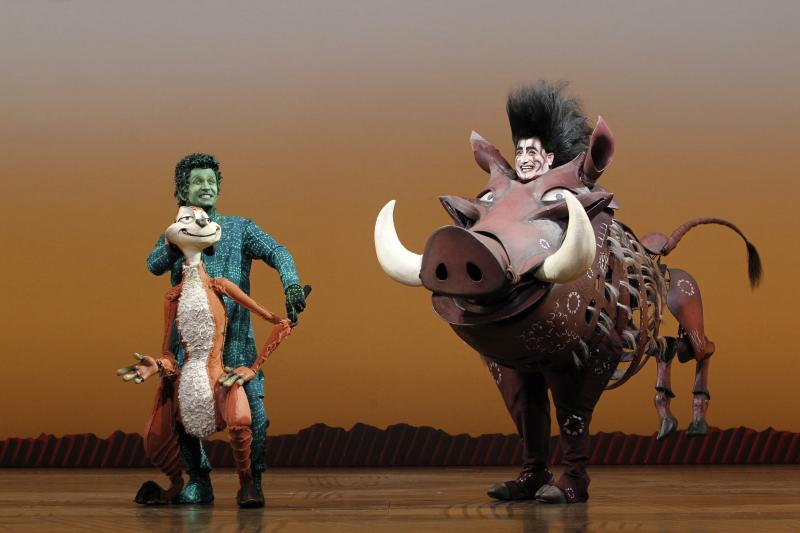 Timon and Pumba puppets and puppeteers. Photo by Joan Marcus.