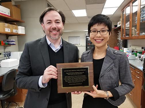 2017 Jonathan Irish and Nalin Leelatian with Best Paper plaque