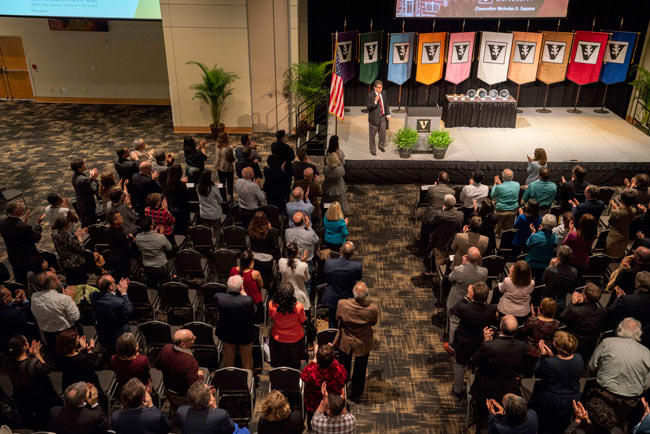 Faculty applaud Chancellor Nicholas S. Zeppos at the spring assembly April 4. (Joe Howell/Vanderbilt)