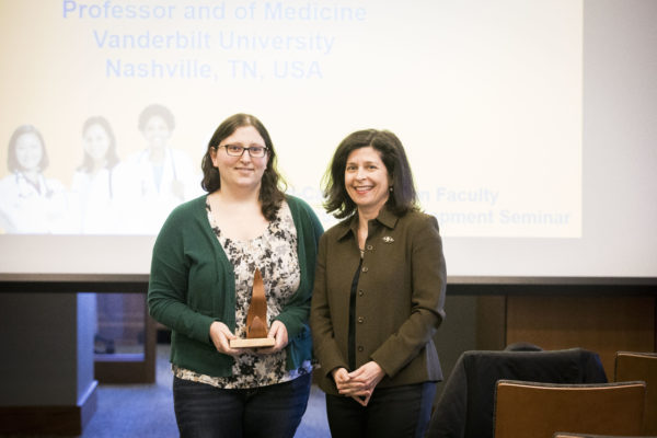 Women's Center Director Rory Dicker presents the Margaret Cuninggim Women's Center Leadership Award to Jessamyn Perimutter, a Ph.D. student in the Department of Biological Sciences. (Susan Urmy/Vanderbilt)