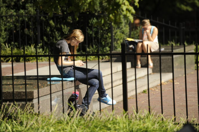 Students study on their laptops outside of Buttrick Hall (John Russell/Vanderbilt University)