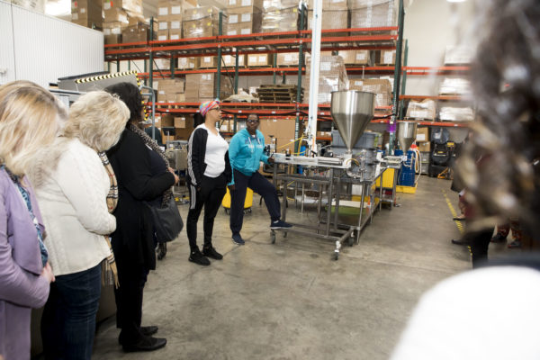 Chancellor's Charter participants touring the production facility at Thistle Farms and hearing the personal narratives of individuals working there. (Susan Urmy/Vanderbilt) <br /> <br />