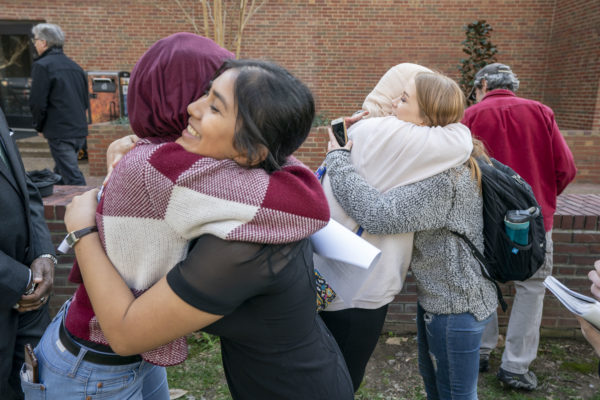 Students hug following the vigil on Monday afternoon.