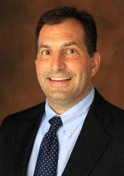 headshot of Vice Chancellor Eric Kopstain