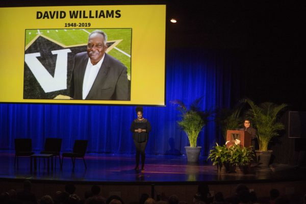 Moment of silence was held prior to Angie Thomas' keynote in honor of former Vice Chancellor for University Affairs and Athletics and Athletic Director David Williams II, who died on Feb. 8 (Joe Howell/Vanderbilt)