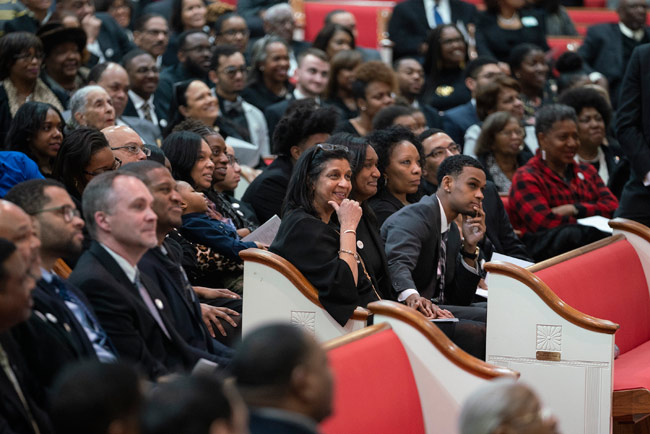 Gail Williams, associate director of Community, Neighborhood and Government Relations at Vanderbilt, and family at the Feb. 15 funeral service. (Joe Howell/Vanderbilt)