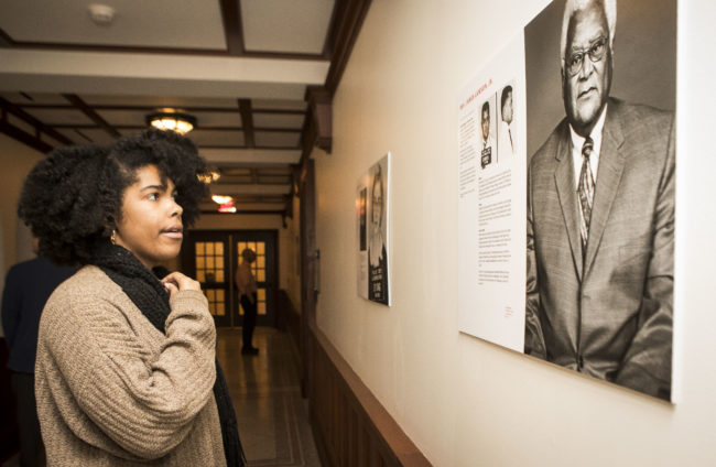Olivia Cherry, a residential adviser for E. Bronson Ingram College, views a portrait of the Rev. James Lawson that is part of a Bronson gallery exhibition of portraits of Freedom Riders. (Susan Urmy/Vanderbilt)