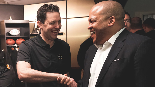 Men's Basketball Coach Bryce Drew (left) welcomes Vice Chancellor for Athletics and University Affairs and Athletics Director Malcolm Turner on Feb. 1. (Vanderbilt University)