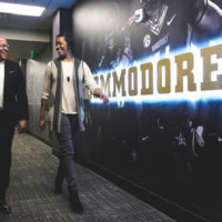 Vice Chancellor for Athletics and University Affairs and Athletics Director Malcolm Turner walks with Senior Associate Athletics Director Candice Lee at the McGugin Center on Feb. 1. (Vanderbilt University)