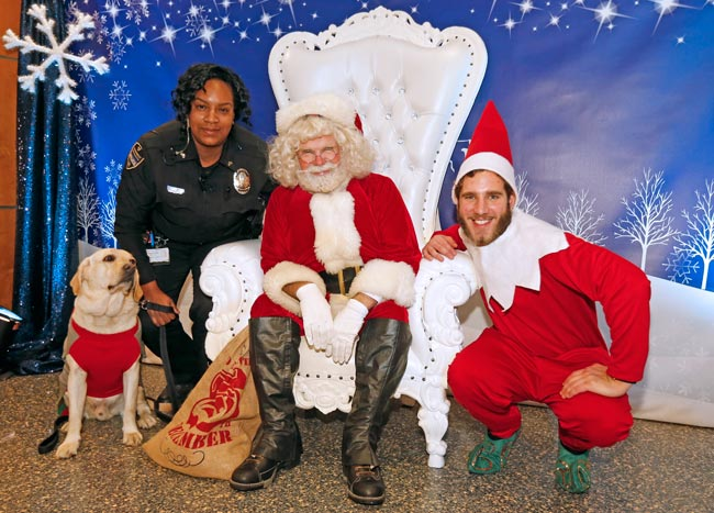 Cpl. Shaneithia Lewis and K-9 officer Jack, Santa and an elf at the 2019 Turkey Toss. (Steve Green/Vanderbilt)