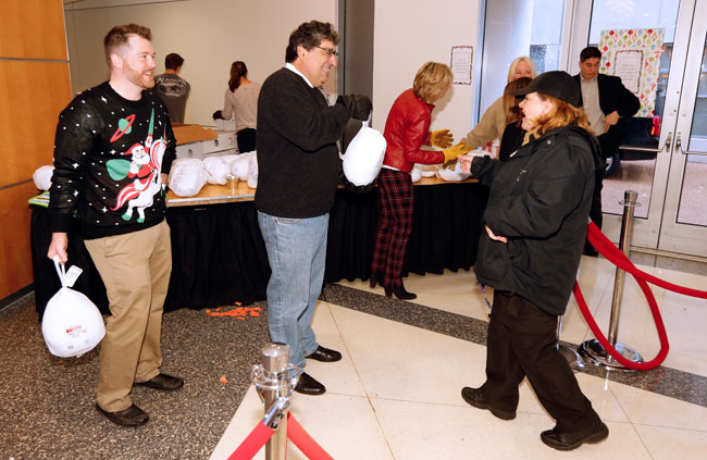 Vice Chancellor for Communications Steve Ertel and Chancellor Nicholas S. Zeppos hand out turkey at the annual Employee Appreciation event. (Steve Green/Vanderbilt)