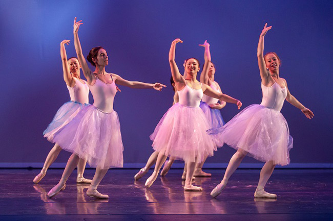 """BME junior Danielle Liu, center, and BME senior Dominque Szymkiewicz, right, perform in VUPointe's 2018 production of """"The Nutcracker."""" (Photo by Madison Lindeman)"""