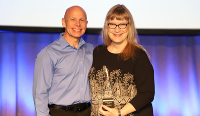 Barbara Carroll (right) receives the Donald E. Dickason Award from Andy Brantley, CEO of CUPA-HR.