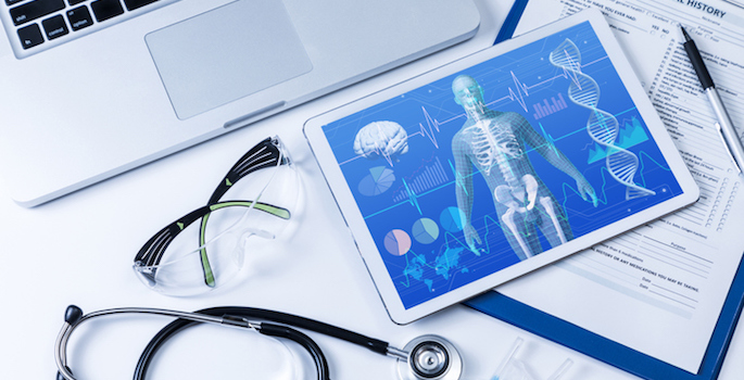 concept of precision medicine or personalized medicine depicting a tablet containing complex health data including x-rays, a laptop, stethoscope and eye shields