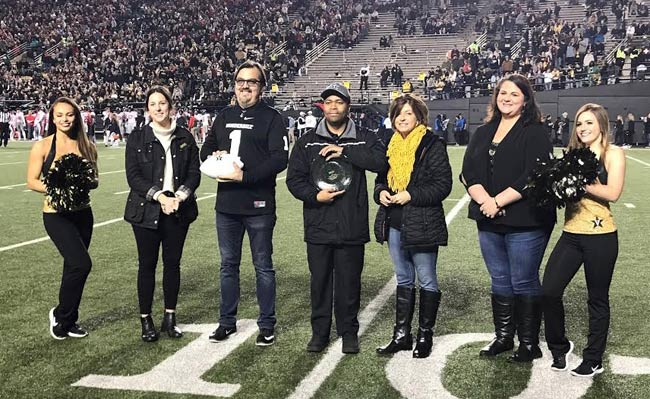 "The Facilities department Controls Group celebrated its title of ""greenest group on campus"" at the Vanderbilt vs. Ole Miss game on Nov. 17. (Vanderbilt University)"