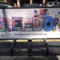 Bus bench with children's art from the Commuter Collective