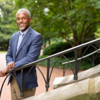 Vice Chancellor for Equity, Diversity and Inclusion and Chief Diversity Officer James Page standing in front of Kirkland Hall (Joe Howell/Vanderbilt)