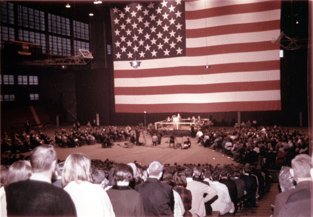 An enormous U.S. flag was the backdrop for the early Impact symposiums (Vanderbilt University)