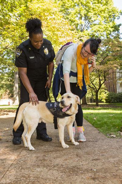 """Community K-9 patrol officer """"Jack"""" with his handler, Cpl. Shaneithia Lewis. (Anne Rayner/Vanderbilt)"""