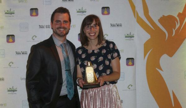 Zac Dupwe and Ashley Majewski accept the university's awards.