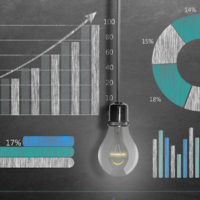 Business growth graphs and charts drawn on chalkboard. Financial data and statistics on blackboard.