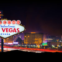 A stock photo of the Welcome to Fabulous Las Vegas Nevada sign with the world famous Las Vegas strip in the background.