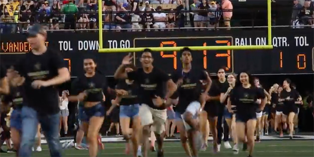 Chancellor Nicholas S. Zeppos and other administrators joined first-year and transfer students and student VUceptors as they stormed the field ahead of the Commodores' season opener against Middle Tennessee State University Sept. 1 at Vanderbilt Stadium. (Vanderbilt University)