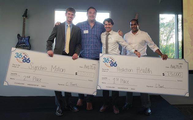 Vanderbilt teams pose with their giant checks at the 36|86 Student Edition pitch competition. From left: Harrison Bartlett; team adviser Robert Grajewski, Evans Family Executive Director of the Wond'ry; Pedro Teixeira and Ravi Atreya. (Submitted photo)