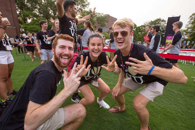 Students flash the VU hand sign at Founders Walk 2018. (Anne Rayner/Vanderbilt)