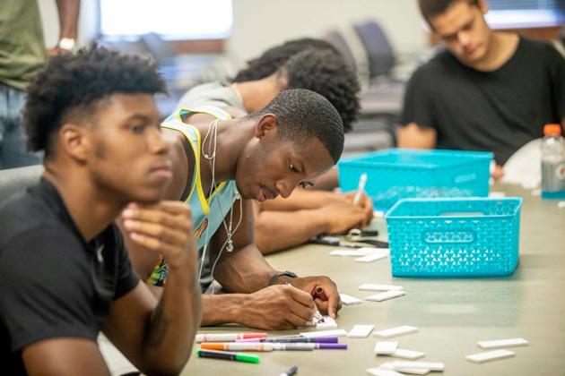 "Student-athletes are encouraged to use their creative skills while decorating ""tiles"" provided by the Wond'ry for a collaborative art workshop. (John Russell/Vanderbilt)"